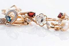 Gold rings, earrings with Topaz and pearls Stock Photography
