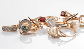 Gold rings, earrings with Topaz and pearls Royalty Free Stock Image