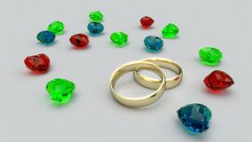 Gold rings end gems hearths Stock Images