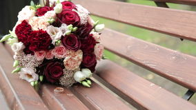 Gold rings, flowers wedding bouquet stock video footage