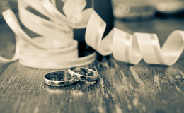 Gold rings of the groom and the bride on a table Royalty Free Stock Images