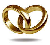 Gold rings in a heart shape Stock Photo