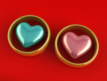 Gold rings hearts Royalty Free Stock Images