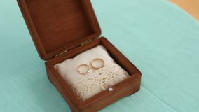 Gold rings lay in a wooden box. Handmade. Close-up stock video footage