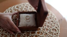 Gold rings lay in a wooden box. Handmade. Close-up stock footage