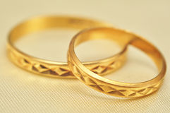 Gold rings macro. Macro of two gold wedding rings Royalty Free Stock Photos