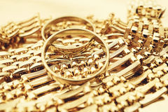 Gold rings and necklace Stock Photos