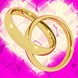 Gold Rings On Pink Heart Bokeh Stock Images