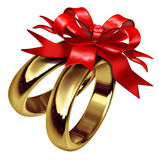Gold rings with red bow and ribbon Stock Photos