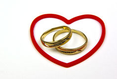 gold rings and red heart Stock Photo