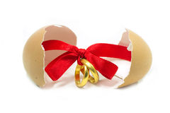 Gold rings tied with red ribbon Stock Photos