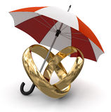 Gold rings under Umbrella (clipping path included). Gold rings under Umbrella. Image with clipping path Royalty Free Stock Photo