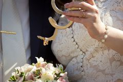 Gold rings wedding couple. On handcuffs Royalty Free Stock Image