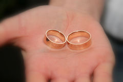 Gold rings for wedding are on the palm of the groom Stock Images