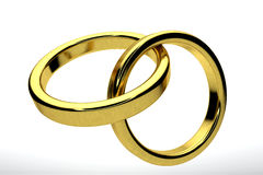 Gold rings on a white background Royalty Free Stock Photos
