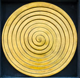 Gold ripple sculpture Stock Images