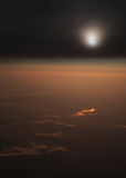 Gold river and clouds. Night flight sun clouds view airplane gold color river Royalty Free Stock Photos