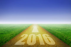 2016 gold road. 2016 on golden road with green grass on each side stock images