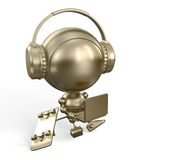 Gold robot toy with notebook & headphones Stock Images