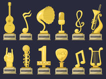 Gold rock star trophy music notes best entertainment win achievement clef and sound shiny golden melody success prize Stock Photos
