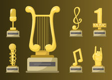 Gold rock star trophy music notes best entertainment win achievement clef and sound shiny golden melody success prize Royalty Free Stock Photo