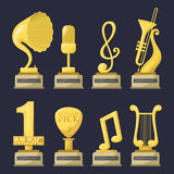 Gold rock star trophy music notes best entertainment win achievement clef and sound shiny golden yellow melody success Stock Image