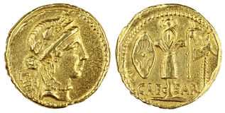 Gold Roman Coin. Front and back view of reproduction gold Roman coin celebrating Caesar's success in the Gallic Wars isolated on white background stock photo