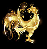 Gold rooster. Artistically painted rooster gold on a dark background Stock Image