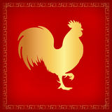 Gold rooster red background Stock Photography