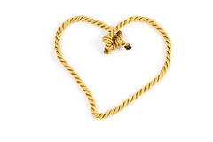 Gold rope with heart shape. On white background Stock Image