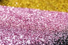 Gold and rose glitter as background stock photos