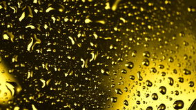 Gold Rotating Water Drops Close Up stock footage