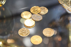 Gold roubles. Scattering of the gilt coins on a glass show-window royalty free stock photo
