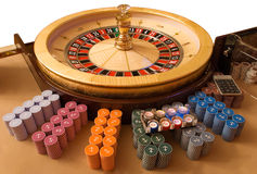 Gold roulette wheel. With other accessories for roulette game royalty free stock image