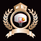 Gold royal display with basketball goal and ball Royalty Free Stock Images