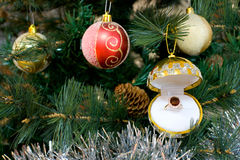 Gold ruby ring as christmas tree decoration Stock Photo