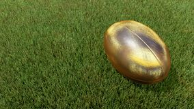 Gold rugby ball on grass V01. Gold rugby ball on grass 3D render for world cup Stock Photos