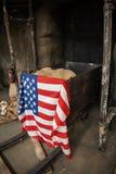 Gold rush mining equipment United states flag stock image