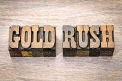 Gold rush in western style wood type. Gold rush - phrase in vintage letterpress wood type - French Clarendon font popular in western movies and memorabilia stock image