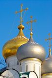 Gold Russian winter. Cupola at sunset. Cold winter evening in Moscow Stock Photo