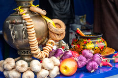 Gold samovar with bagels composition Stock Images