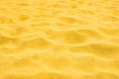 Gold sand of a beach in the summer. Clean granular royalty free stock photo