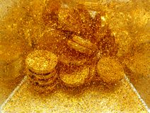 Gold sand and gold coins Royalty Free Stock Photo