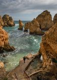 Gold sandstone cliffs in Portugal royalty free stock images