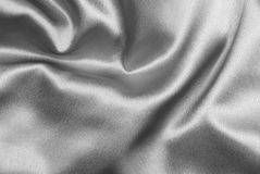 Gold satin. Beautiful and shiny silver satin background - for luxury designs Royalty Free Stock Image