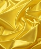 Gold satin. Texture close up Stock Photo
