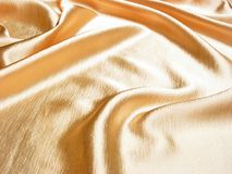 Gold satin background. Soft luxury gold satin background Royalty Free Stock Photos