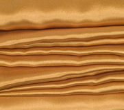Gold Satin Background With Folds Stock Photo