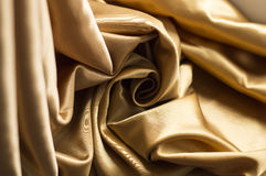 Gold satin fabric Royalty Free Stock Images