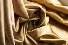 Gold satin fabric Stock Photo